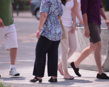 Cream trousers long legs young adult woman walking Stock Footage