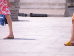 Flowery skirt long naked legs young adult women walking Stock Footage