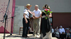 Accordion contest anniversaries long textile ribbon bouquet Stock Footage