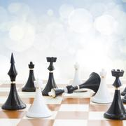 Checkmate white defeats black king Stock Photos