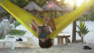 Stock Video Footage of Woman on hammock with tablet