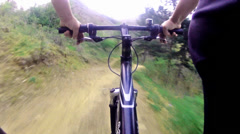 Cyclist riding down a difficult track. cycling track.pov Stock Footage