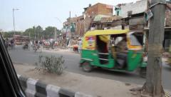 Traffic out of taxi window in Old Delhi Stock Footage