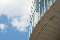 Stock Photo of architecture with sky and cloud reflection