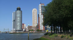 Wilhelminapier at Kop van Zuid, ROTTERDAM + pan Erasmus Bridge and skyline Stock Footage