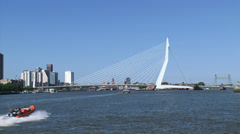 ROTTERDAM Erasmus Bridge, river Nieuwe Maas + skyline city north. Stock Footage