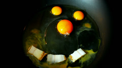 Smiley food, 30 second- two quail eggs a chicken egg and bacon  in a pan Stock Footage