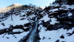 River landscape. snow covered mountains. aerial view. fly over Stock Footage