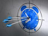 Stock Illustration of Time concept: arrows in Alarm Clock target on wall background