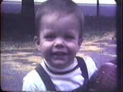 Toddler Plays Football 1969 Stock Footage