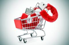 sexy fluffy handcuffs in a shopping kart - stock photo
