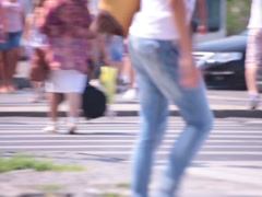 superb jeans legs young adult woman walking street - stock footage
