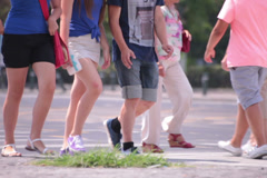 Two beautiful young adult women and man walking on street Stock Footage