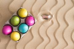 Traditional easter egg hunt on a tropical beach Stock Photos