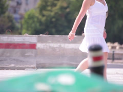short white dress walking young adult woman street - stock footage