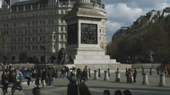 Trafalgar Square Lion statues with tourists Stock Footage