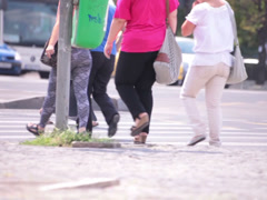Long black skirt flowery shirt young adult woman walking street Stock Footage