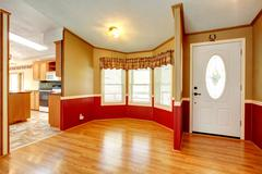 house interior with red wood plank wall trim - stock photo