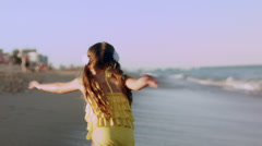 Five Year Old Girl Runs Down The Beach, Jumps And Twirls Beside Waves Stock Footage