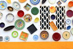 Artisan's wall of handpainted plates - stock photo