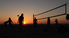 Sunset Silhouette People Playing Volleyball At Beach, Summer HD Stock Footage