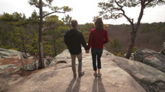 Young couple walk away - stock footage