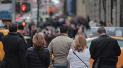 Crowd of people waiting traffic light on street in New York City Stock Footage