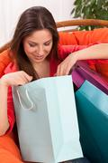 Woman with shopping bags at home Stock Photos