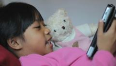 Close Up-Little Girl Reads Book To Stuffed Bear Stock Footage