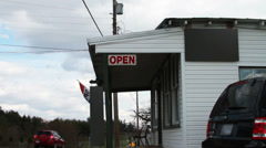 1179 Small Business with Open Sign and Flag Stock Footage