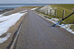 Dike along the Wadden Sea. Stock Photos