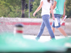 Bluejeans couple walking street Stock Footage