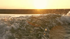 Dam lake at sunset.Water was sprayed on the solar path Stock Footage