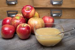 Applesauce on a wooden table Stock Photos