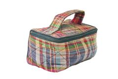 Small carry bag with zip in checked fabric Stock Photos