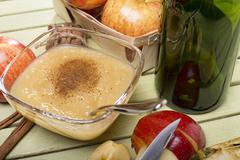 healthy organic applesauce with cinnamon - stock photo