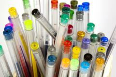 closeup of pen collection in bright colors - stock photo