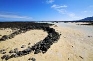 Stock Photo of people spain  hill white  beach  spiral of black rocks     lanzarote
