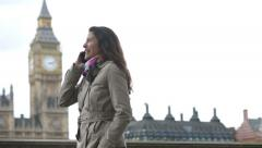 Attractive young woman walking along the South Bank of London Stock Footage