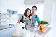 Stock Photo of couple in kitchen