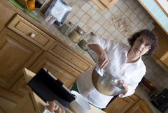 Mature woman makes the pastry Stock Photos