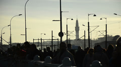 Silhouette of walking people and electric poles on Galata Bridge at Istanbul  Stock Footage