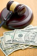 Judge gavel and dollars Stock Photos