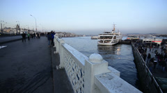 Istanbul, Galata, People walking on the floating, pontoon bridge, banister, day  Stock Footage