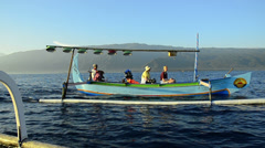 Tourists in a indonesian fisher-catamaran called Jukung Stock Footage