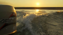 Motorboat makes waves at sunset Stock Footage