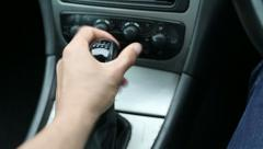 Male hand changing gears in a car Stock Footage
