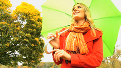 Young Girl Umbrella Sheltering from Climate Stock Footage