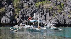 Tourist boats in lagoon.  El Nido, island Palawan, Philippines. Stock Footage
