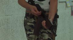 Asian Girl Aiming AKS-74U - 003 Stock Footage